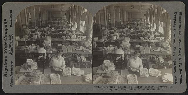 Inspecting sheets of paper money, Bureau of Printing and Engraving, Washington, D.C. Keystone View Company, Manufacturers and Publishers, c1917. //hdl.loc.gov/loc.pnp/stereo.1s02936