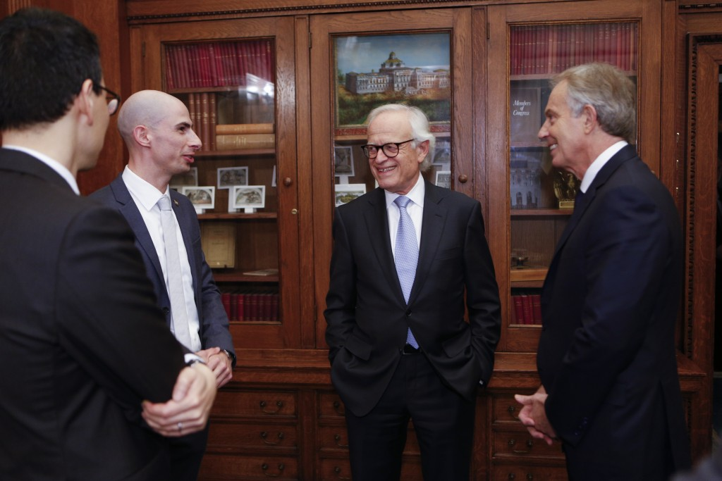 Jason Steinhauer of the Kluge Center prepares moderator Martin S. Indyk and former Prime MInister of Great Britain and Northern Ireland Tony Blair for the Kissinger Lecture Series in the Great Hall, December 3, 2015. Photo by Shawn Miller.