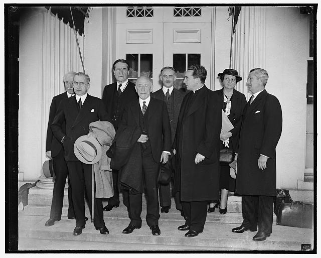 Aid to refugees planned at White House. Washington, D.C., April 13. Experts on the refugee problem shown leaving the White House today after conferring with President Roosevelt, the group met with the President to go over preliminaries to an international conference to help political refugees from Germany and Austria (Harris & Ewing, photographer, April 13, 1938) (Source: Library of Congress Prints and Photographs Division).