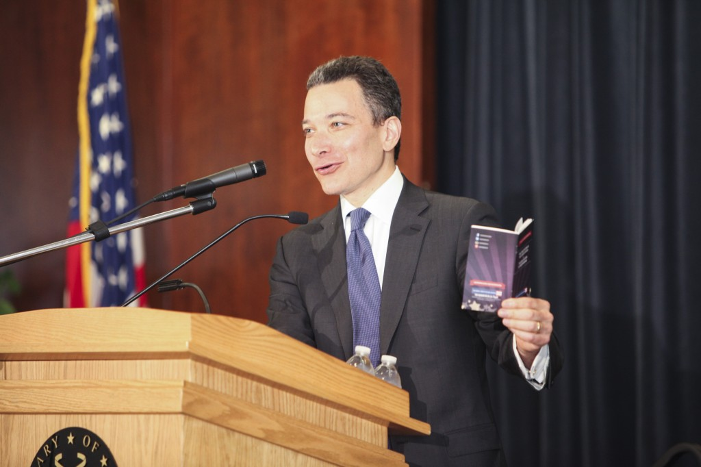Jeffrey Rosen reads the 14th Amendment from his pocket edition of the Constitution. Law Day 2014.  Photo by Amanda Reynolds