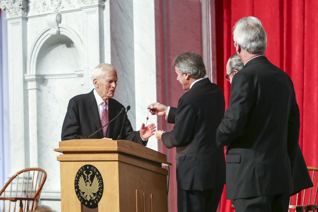 Librarian of Congress Dr. James H. Billington (left) accepts the ceremonial key to Magna Carta's case from British Ambassador to the United States, Sir Peter Westmacott, while Lord Lothian (second from right) and Lincoln Cathedral's Dean Buckler (right) look on. [Photo by Amanda Reynolds]