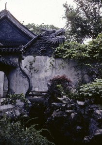 Exterior garden space with dragon head atop a wall at a temple in Shanghai, China by Norwood, Jean E., 1979. Library of Congress Prints and Photographs Division, //www.loc.gov/pictures/resource/ppss.00498/.