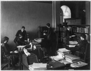 Six People working in the Legislative Reference Service of the Library of Congress. View in old wing before rebuilding for Union Catalog. Dr. Bernard is shown on the right. Photograph by L.C. Handy. (Created in 19250. Library of Congress Prints and Photographs Division, //hdl.loc.gov/loc.pnp/cph.3a51505