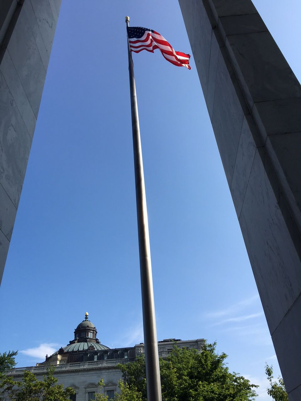 Flag in front of the Madison / Photograph by Andrew Weber