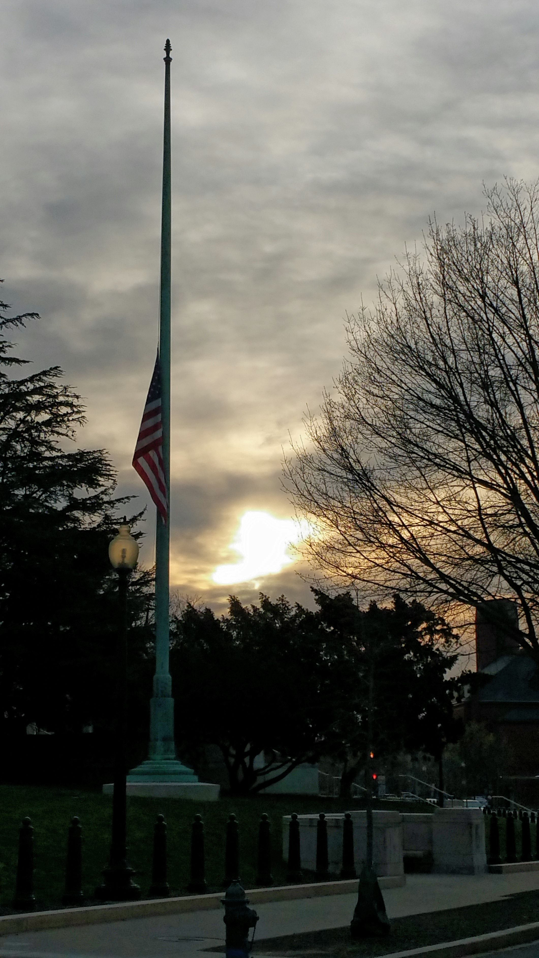 Flag at half mast on the south side of the Library of Congress Adams Building / Photograph by Kimberly Allen