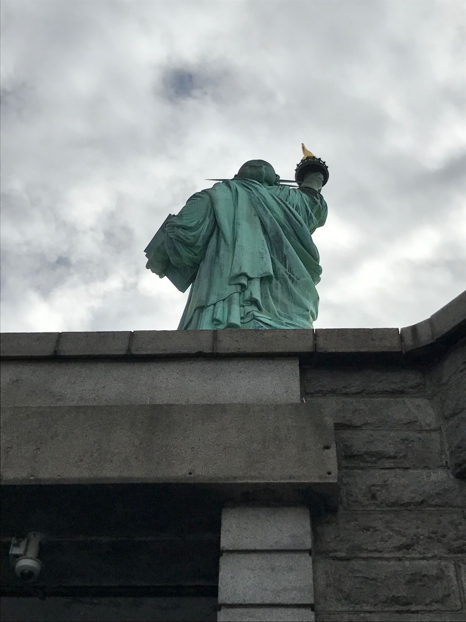 Statute of Liberty from the back, looking upwards / Photograph by Andrew Weber