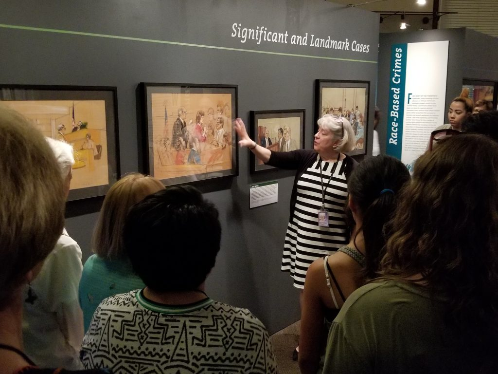 Margaret Wood conducts a gallery tour of the exhibition, Drawing Justice, on June 21, 2017. Photo by Kimberly Allen.