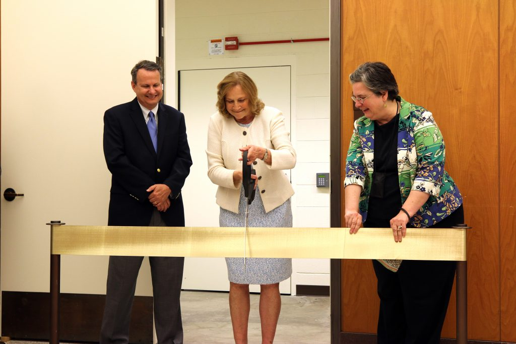 Principal Deputy Librarian of Congress Mark Sweeney (left), and Chief of Prints and Photographs Division Helena Zinkham (right) join Law Librarian of Congress Jane Sánchez as she cuts the ceremonial ribbon to open the Law Library's new secure storage facility on June 28, 2019. Photo by Donna Sokol.