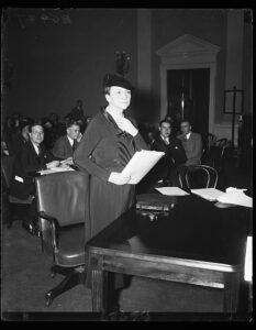 Secretary of Labor, Frances Perkins, photographed as she prepared to testify on the Administration's Social Security program before the House Ways and Means Committee. 1/22/35