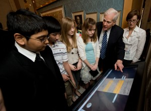 Students and Dr. Billington interact with a Library of Congress Experience kiosk