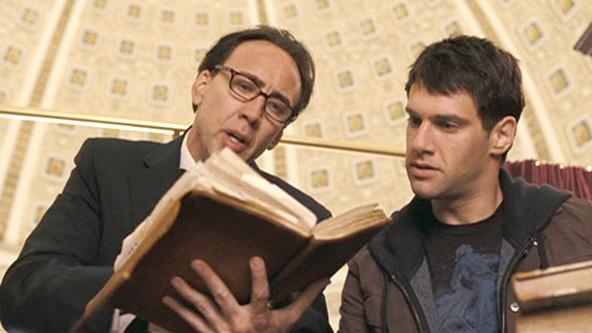 Ben Gates and Riley Poole peruse the Book of Secrets