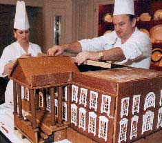 Executive pastry chefs during Bill Clinton's tenure prepare a gingerbread White House