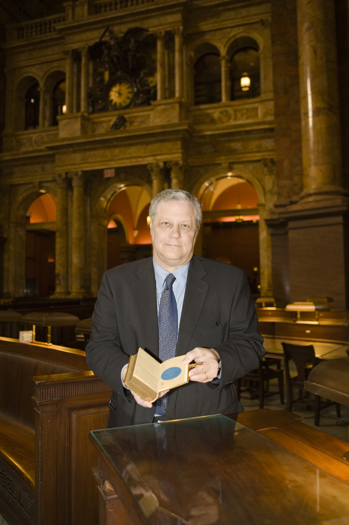 Mark Dimunation, chief of the Library of Congress' Rare Books and Special Collections Division, in the Library's Main Reading Room, holds open the 1861 Lincoln Inaugural Bible to the page signed by the clerk of the Supreme Court, William Thomas Carroll