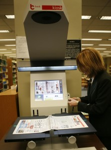 The new book2net scanner functionality is demonstrated by Teri Sierra, Assistant Chief of the Serial and Government Publications Division. (Library of Congress/Abby Brack photo)
