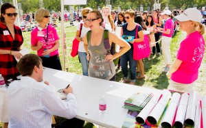 Author signing books at 2012 National Book Festival