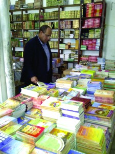 Ismail Soliman, former head of monograph acquisitions in the Library's Cairo office, searches for library materials in a bookshop in Mauritania. Overseas Operations Division.