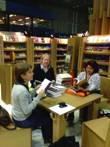 Librarians in Rio de Janerio work at the Rio Book Fair at a booth constructed from recycled paper. Overseas Operations Division.