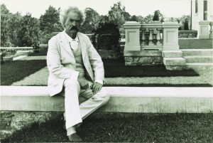Samuel Clemens (Mark Twain) poses in his classic white suit, 1905. George Edward Perine, Prints and Photographs Division.
