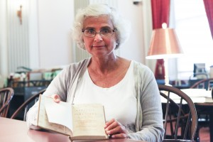 Anna Bryan holds the book she discovered in the Law Library's rare-book collections. Photo by Amanda Reynolds.