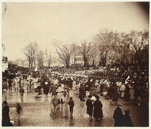 Crowds wade through pools of water and mud to attend Abraham Lincoln's second inauguration, held on the east front of the United States Capitol, March 4, 1865. Prints and Photographs Division, Library of Congress.