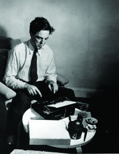 Folklorist Alan Lomax at work at his manual typewriter, 1942.