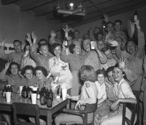 Servicemen and servicewomen raise a toast to victory on VJ Day in 1945. Veterans History Project.