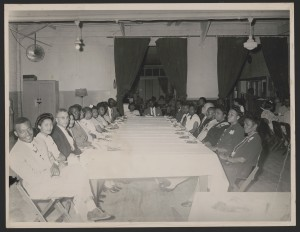 Rosa and Raymond Parks, seated at a banquet table (left side, third and fourth chair), likely at an NAACP branch meeting, Montgomery, Alabama, circa 1947.  Photographer not identified.