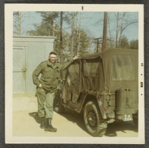 Edwin Mark Trawczynski, in uniform, standing against a jeep at Charlie Aid Station, Vietnam, March 1969. Veterans History Project. //memory.loc.gov/diglib/vhp-stories/loc.natlib.afc2001001.76819/album