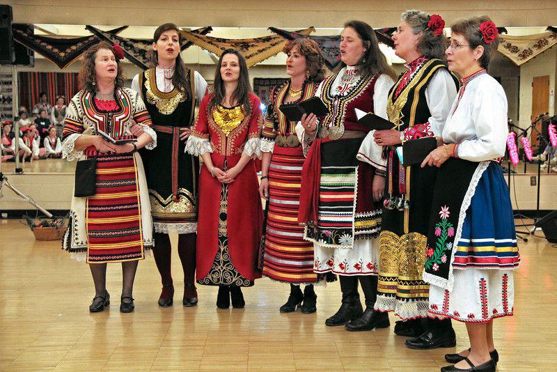 "The Balkan singing group Slaveya performing at a National Folk Organization event. The group includes several Library of Congress employees, including AFC's Theadocia Austen. For them, Balkan singing and costume are ""MyTradition."" L-r: Anne Harrison, Katie Kathryn, Tzvety Weiner, Theadocia Austen, Betsy Smith Platt, Karen Chittenden and Helen Fedor.  Courtesy of Theadocia Austen."