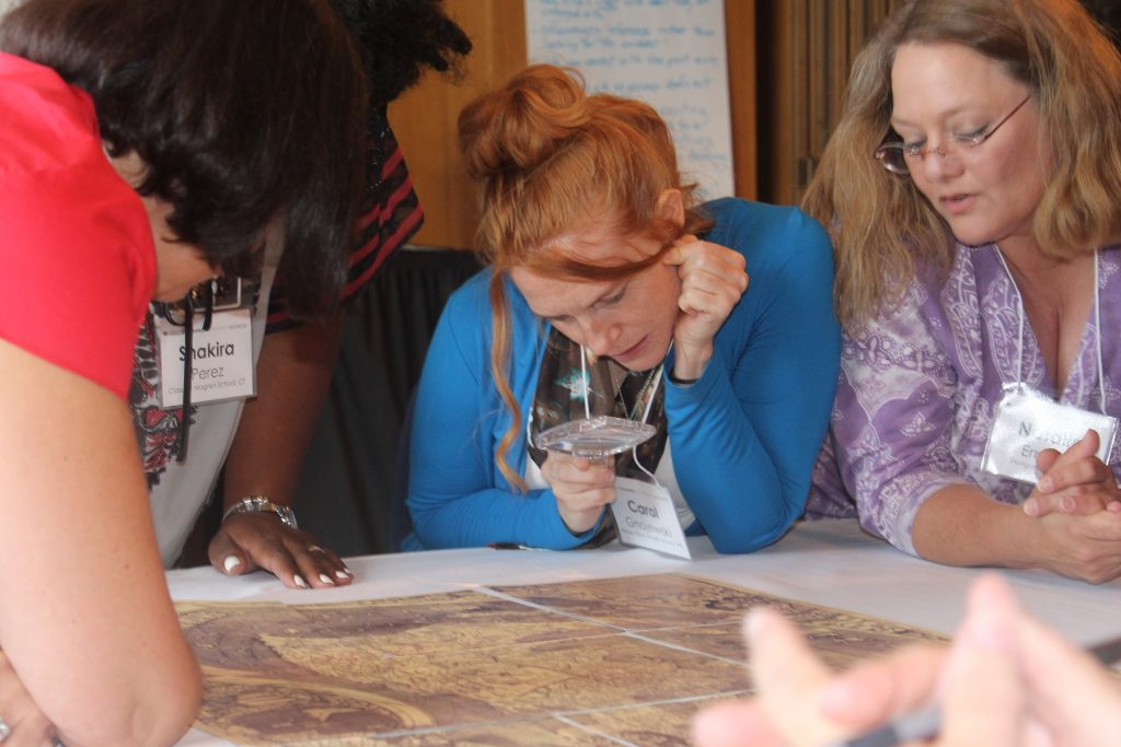 Carol Gnojewski and other educators analyze maps during one of the Library of Congress Summer Teacher Institutes. Photo by Stephen Wesson.