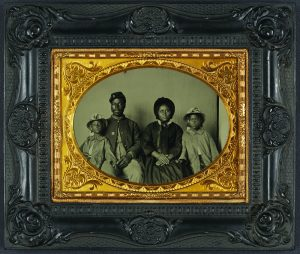 This Civil War era photograph of an African American Union soldier with his wife and daughters is one of many that inspired a recent exhibition at the California African American Museum.
