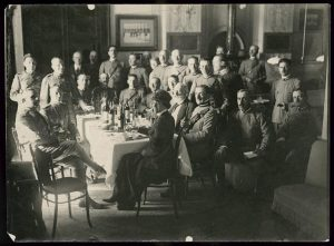 Helen Johns Kirtland seated at table with Italian military officers near the Piave River, Italy, October 1918. Prints and Photographs Division.