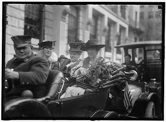 Jeannette Rankin, right, in carriage with Carrie Chapman Catt, center, upon Rankin's arrival in Washington, D.C.