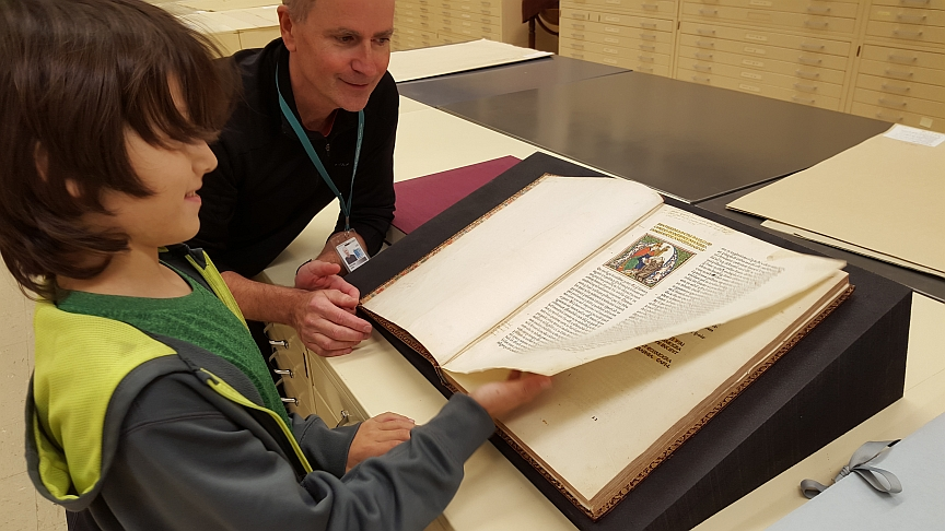 Lucas Crooper looking at the first pages of the 1482 edition of Ptolemy's Geographia. Photograph by Margherita Paminella