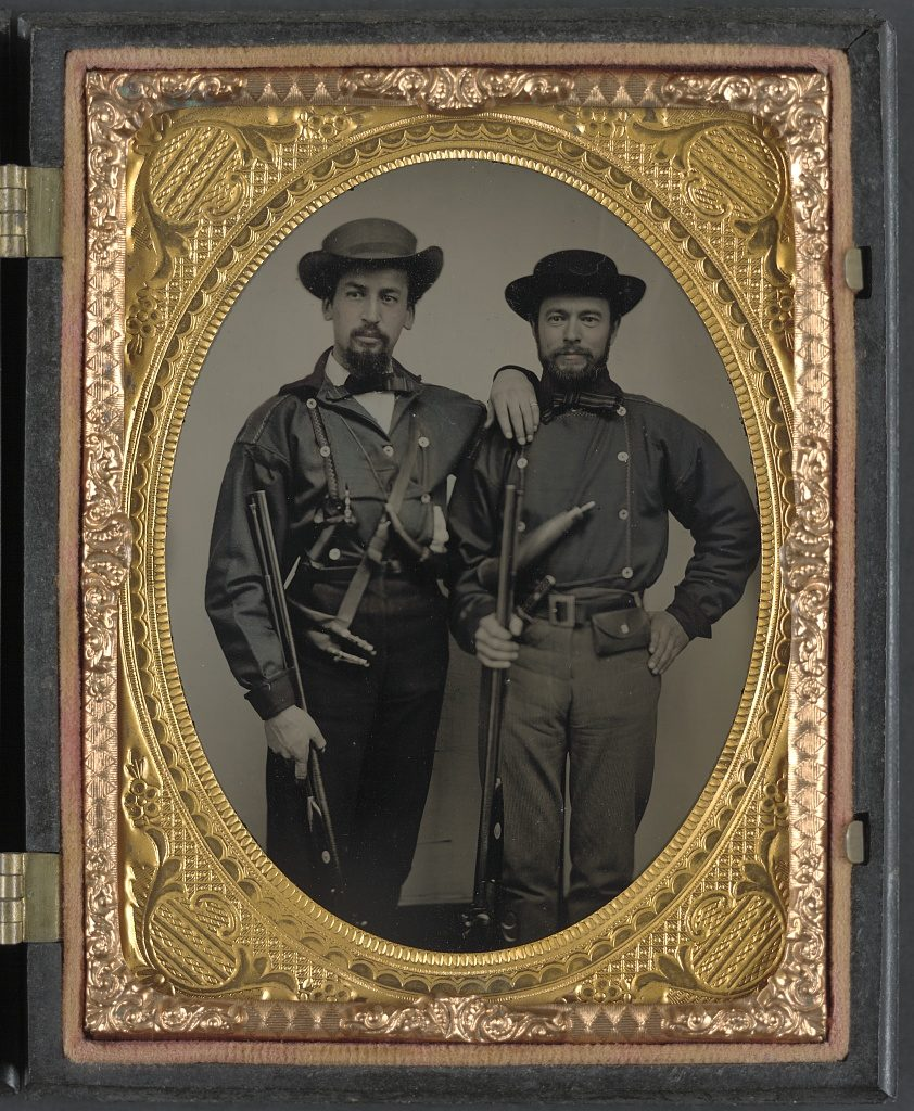 Two unidentified soldiers in Mississippi battle shirts with double barrel shotguns, knives, and powder horns. Photo, between 1861 and 1865. Library of Congress, Prints and Photographs Division.