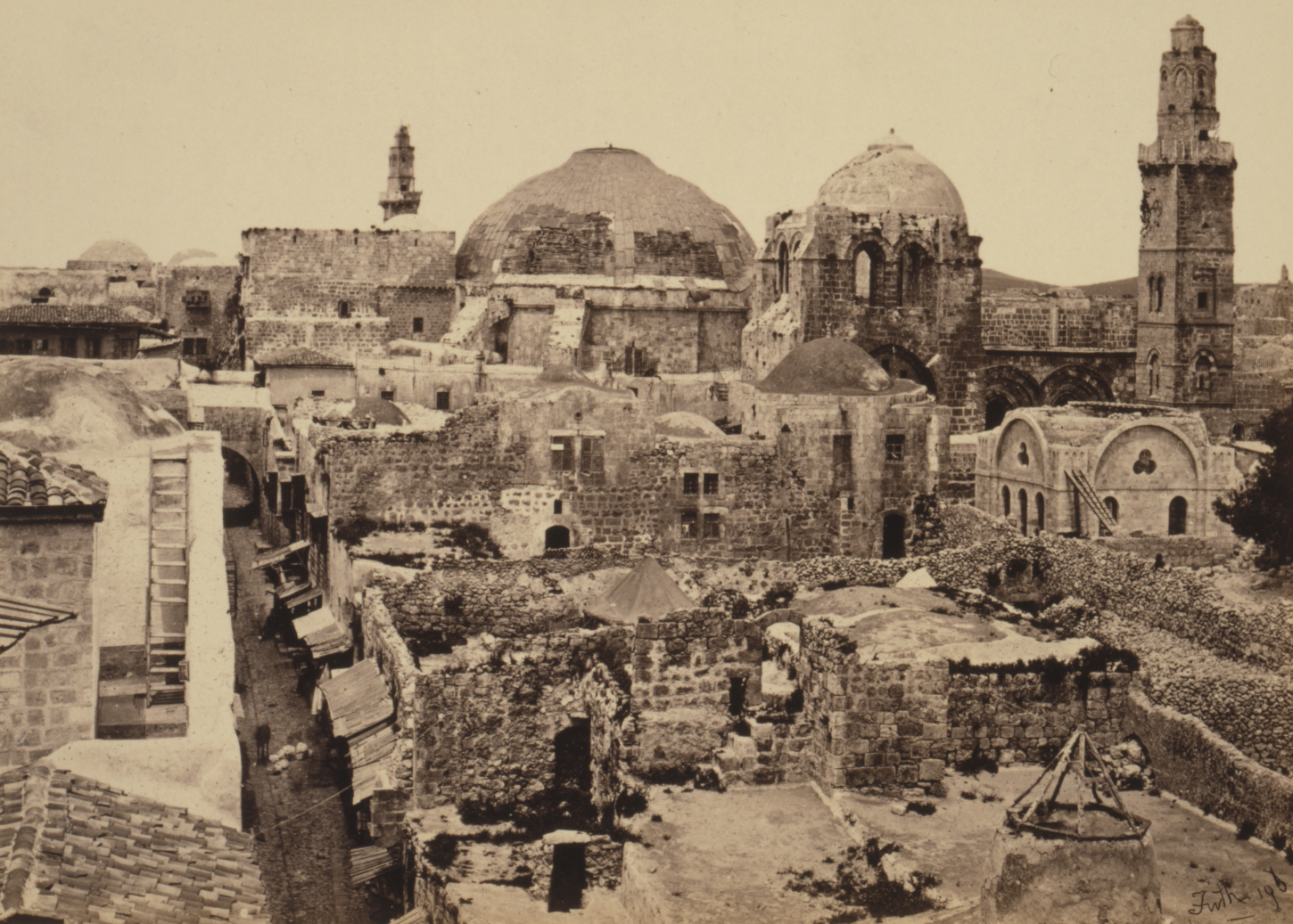 View of domes and minarets in the background, lower lying ruins in the foreground.
