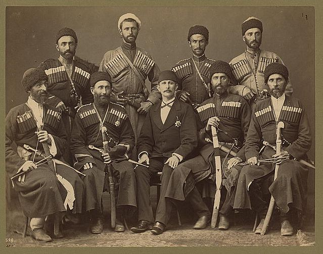 Group portrait of eight Circassian men in uniform, with another man, possibly an Ottoman official, 1880-1900.  Most of the refugees settled in Turkey, where, for a period, they were forbidden to speak Circassian, and where they remain today.  Prints and Photographs Division.