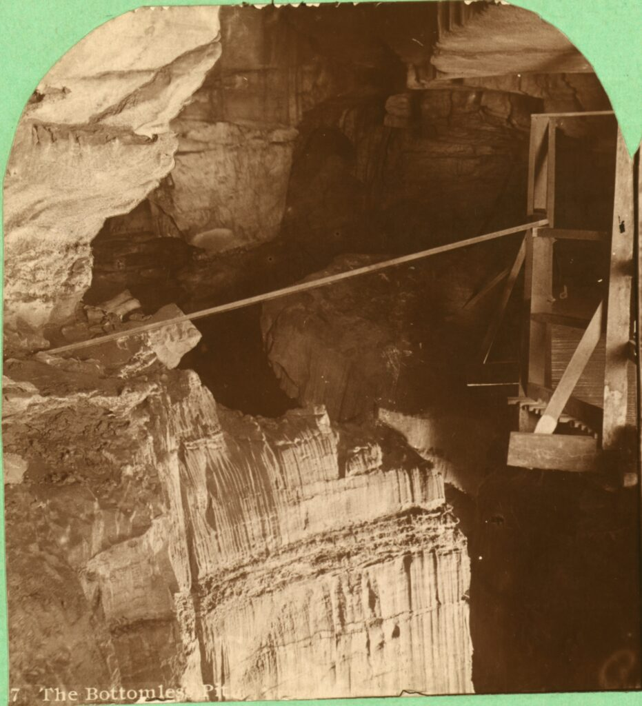 A black and white photograph of a large pit in Mammoth Cave.