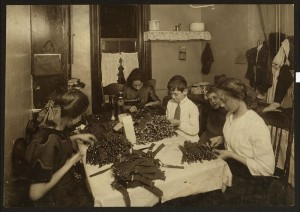 Jewish family working on garters in kitchen for tenement home. Lewis Hines, photographer, November 1912.