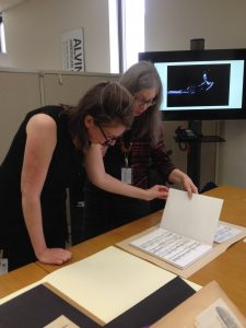 Kate Doyle (left) and Libby Smigel examine one of Lucia Dlugoszewski's scores. (Photo by Mary Wedgewood, Music Division, Library of Congress.)