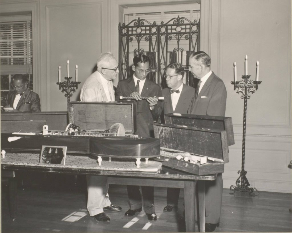 His Majesty, King Bhumibol Adulyadej of Thailand, visited the Library of Congress on June 29 [1960] as part of his official visit in the Nationa's Capital. Pictured viewing the Thai musical instruments, which were a gift of His Majesty's to the Library, are left to right: Harold Spivacke, Chief of the Library's Music Division, His Majesty, Cecil Hobbs, Head of the South Asia Section, Library of Congress, and Librarian of Congress L. Quincy Mumford.
