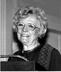 Photograph of Cyrilla Barr giving a lecture in Coolidge Auditorium c. 1997.