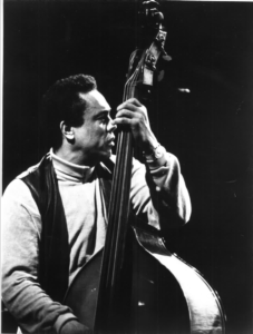 Portrait of Charles Mingus with double bass.