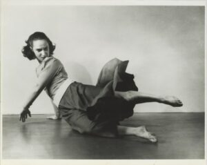 Anna Sokolow in dance pose on the floor