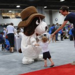 Ned the Newshound from the Washington Post greets a young fan at the National Book Festival, September 5, 2015. Photo by Shawn Miller.