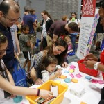 Aziz and Naseem Jan, festival regulars from Pakistan, enjoy a Scholastic craft table with their daughters during the National Book Festival, September 5, 2015. Photo by Shawn Miller.