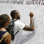 Visitors inscribe a wall with what they would miss most due to illiteracy during the National Book Festival, September 5, 2015. Photo by Shawn Miller.