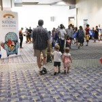 A family makes their way through the National Book Festival at the Walter E. Washington Convention Center, September 5, 2015. Photo by Shawn Miller.