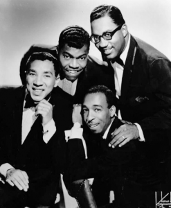 Photograph of Smokey Robinson and the Miracles, February 1966. Public Domain.