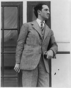 George Gershwin, 1898-1937, three-quarters length portrait, standing, facing right. Photograph, no date.